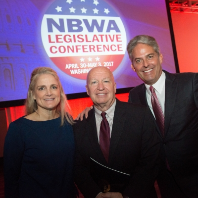 NBWA EVP Government Affairs Laurie Knight, Rep. Kevin Brady (TX) and Faust Distributing Co. Chairman & CEO Don Faust